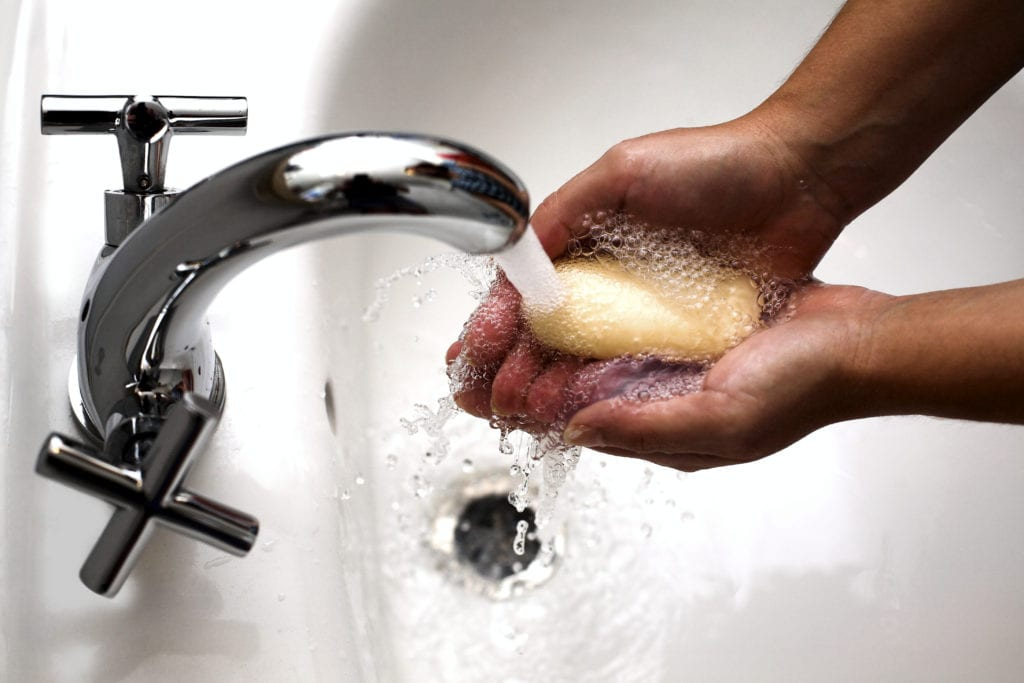 washing hands with bar of soap